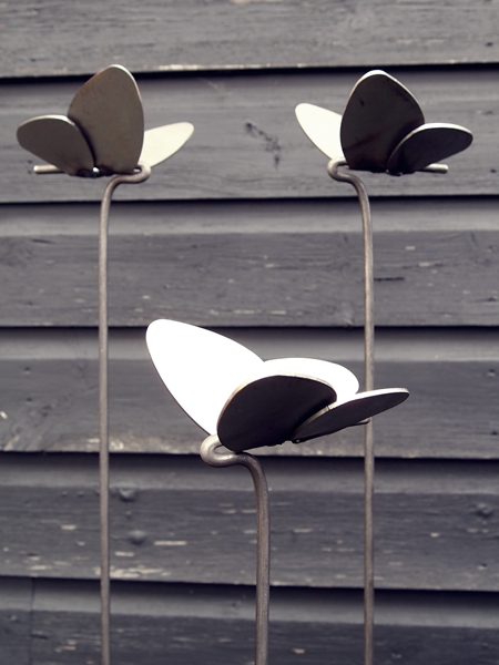 Three steel butterflies