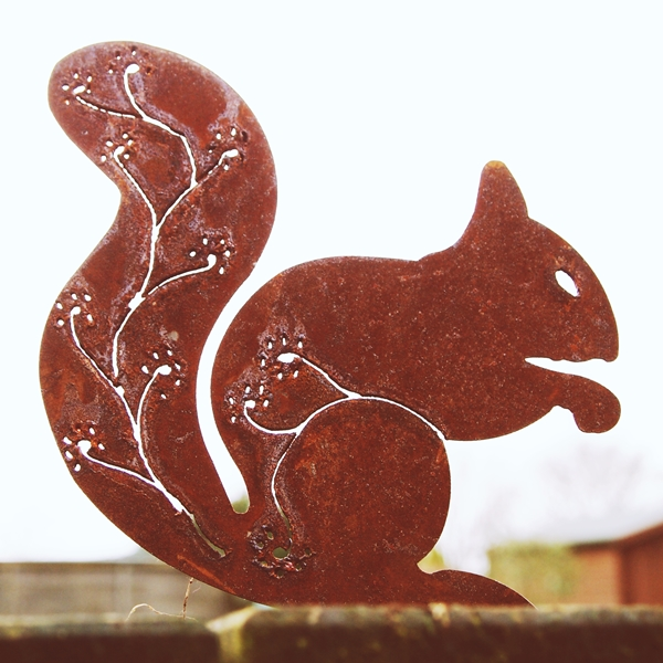 Rusty steel red squirrel with flower pattern tail
